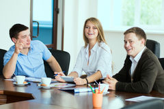 Young business woman with business partners, men at a business m Stock Photo