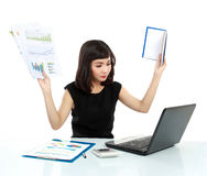 Young business woman busy with laptop Stock Image
