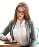 Young business woman busy working in office on white Royalty Free Stock Image