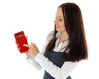 Young business woman with calculator. Stock Photos