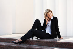 Young business woman calling on the cell phone. Young fashion business woman calling on the cell phone Stock Photos