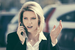 Young business woman calling on cell phone outdoor Stock Photography