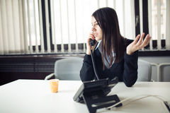 Young business woman calling and communicating with partners.Customer service representative on the phone Royalty Free Stock Images