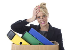 Young Business Woman Carrying a Box of Files Stock Photography