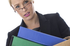 Young Business Woman Carrying a Box of Files Stock Photos