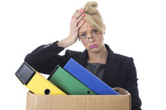 Young Business Woman Carrying a Box of Files Royalty Free Stock Photos