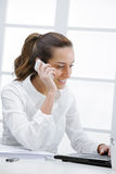 Young business woman with a cell phone Royalty Free Stock Photo