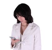 Young business woman with cell phone. Young business woman holding a cell phone isolated on a white background Stock Images