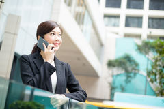 Young business woman chat on mobile phone royalty free stock image