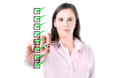 Young business woman checking on checklist boxes, white baclground. Stock Image