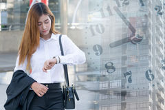 Young business woman checking the time Stock Image