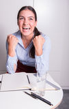 Young business woman is cheering her success royalty free stock photo