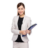 Young business woman with clip board Stock Image