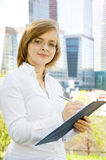 Young business woman with clipboard Royalty Free Stock Photos
