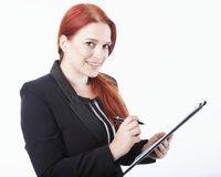 Young business woman with clipboard in her hand Royalty Free Stock Photos