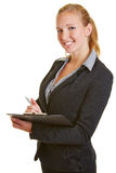 Young business woman with clipboard Royalty Free Stock Photo