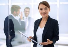 Young business woman with clipboard stock images