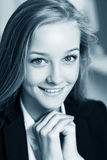 Young business woman on close-up portrait Royalty Free Stock Image
