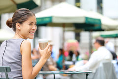 Young business woman coffee break in city park. Drinking coffee. Happy smiling multiracial young businesswoman in Bryant Park, New York City, USA stock photography