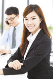 Young business woman with colleague in office. Pretty young business women with colleague in office Stock Photo