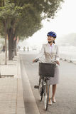 Young Business Woman commuting with a Bicycle, Beijing, China Stock Photos