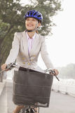Young Business Woman commuting with a Bicycle, Beijing, China Stock Image