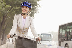 Young Business Woman commuting with a Bicycle, Beijing, China Royalty Free Stock Photo