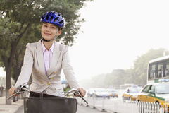 Young Business Woman commuting with a Bicycle, Beijing, China Royalty Free Stock Photography