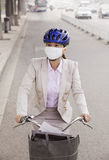 Young Business Woman commuting with a Bicycle, Beijing, China Stock Photography