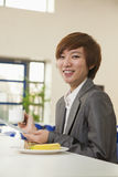 Young business woman in company cafeteria Royalty Free Stock Photo