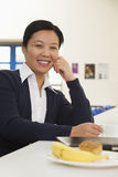Young business woman in company cafeteria Stock Images