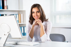 Young business woman with computer Stock Photography