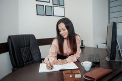 Young business woman with computer in the office stock photos