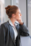 Young business woman in a comtemplative mood Stock Photos