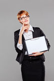 Young business woman confidently presenting a clipboard Stock Images