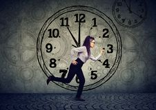 Business woman running out of time. Young business woman corporate employee running out of time has busy schedule Royalty Free Stock Photo
