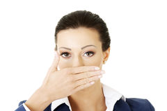 Young business woman covering her mouth Stock Photo