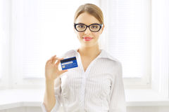 Young business woman with credit card Stock Image