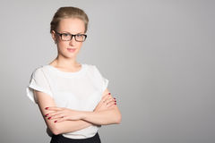 Young business woman crossed arms Royalty Free Stock Photos