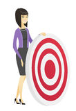 Young business woman and dart board. Stock Photography