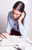 Young business woman is depressed over her work Stock Image