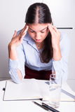 Young business woman is depressed over her work stock photo