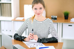 Young business woman designer working on laptop in office. Successful startup business concept. Stock Images