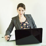 Young Business Woman at Desk Stock Photos