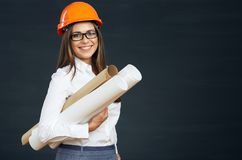Young business woman developer with blueprint. Smiling architect woman. Black background Stock Photo