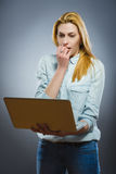 Young business woman disgusted by the content on her laptop Royalty Free Stock Photography