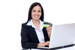 Young business woman doing online shopping. Happy young business woman doing online shopping against white Stock Photos
