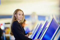 Young business woman doing self check-in in international airport terminal Stock Photography