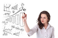 Young business woman drawing diagrams on whiteboard royalty free stock image