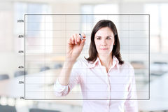 Young business woman drawing on empty graph. Young business woman drawing on empty graph 1. Office background Stock Photos